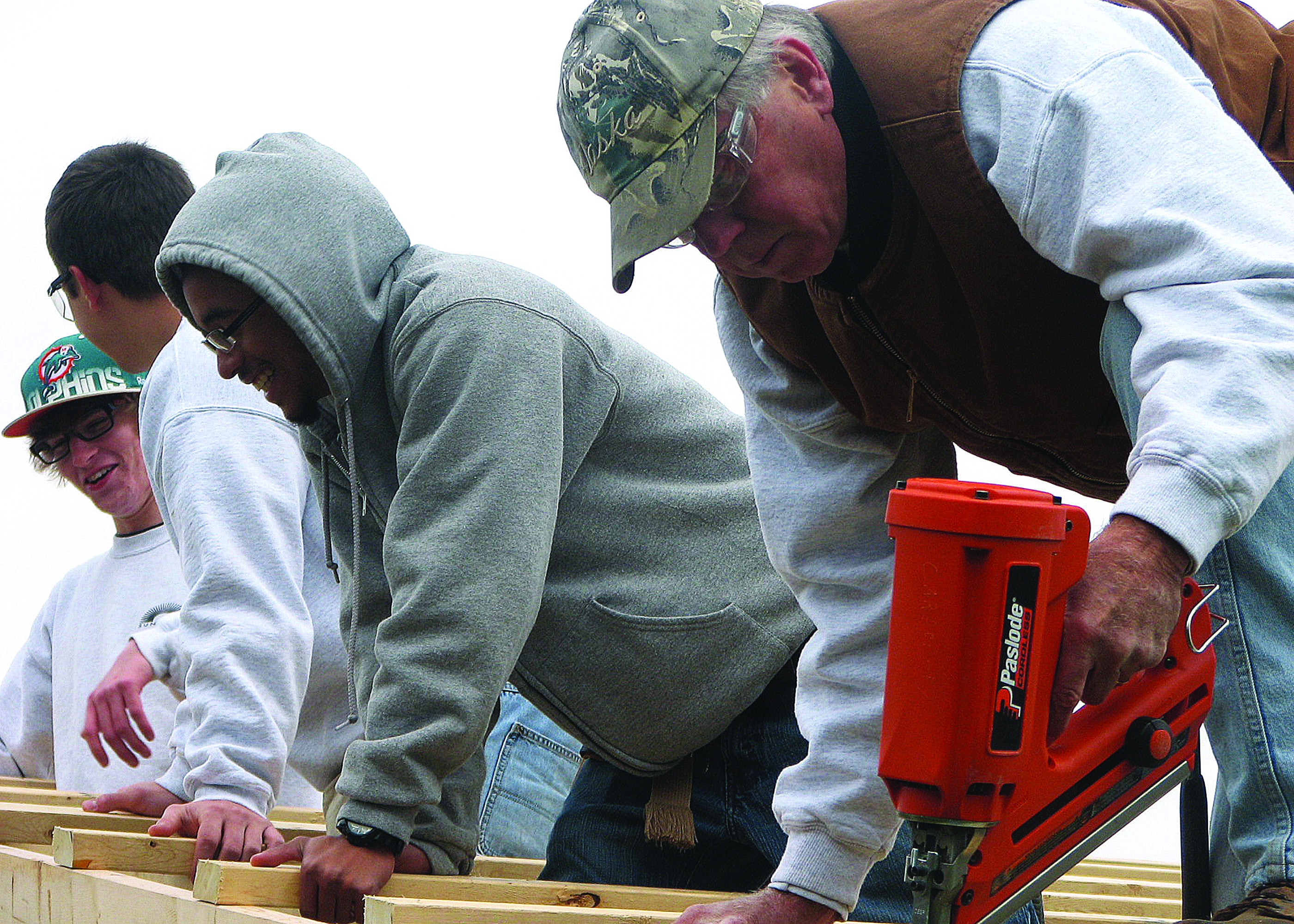 Adult and high school students from carpentry work side-by-side to complete SUN Tech's pavilion.