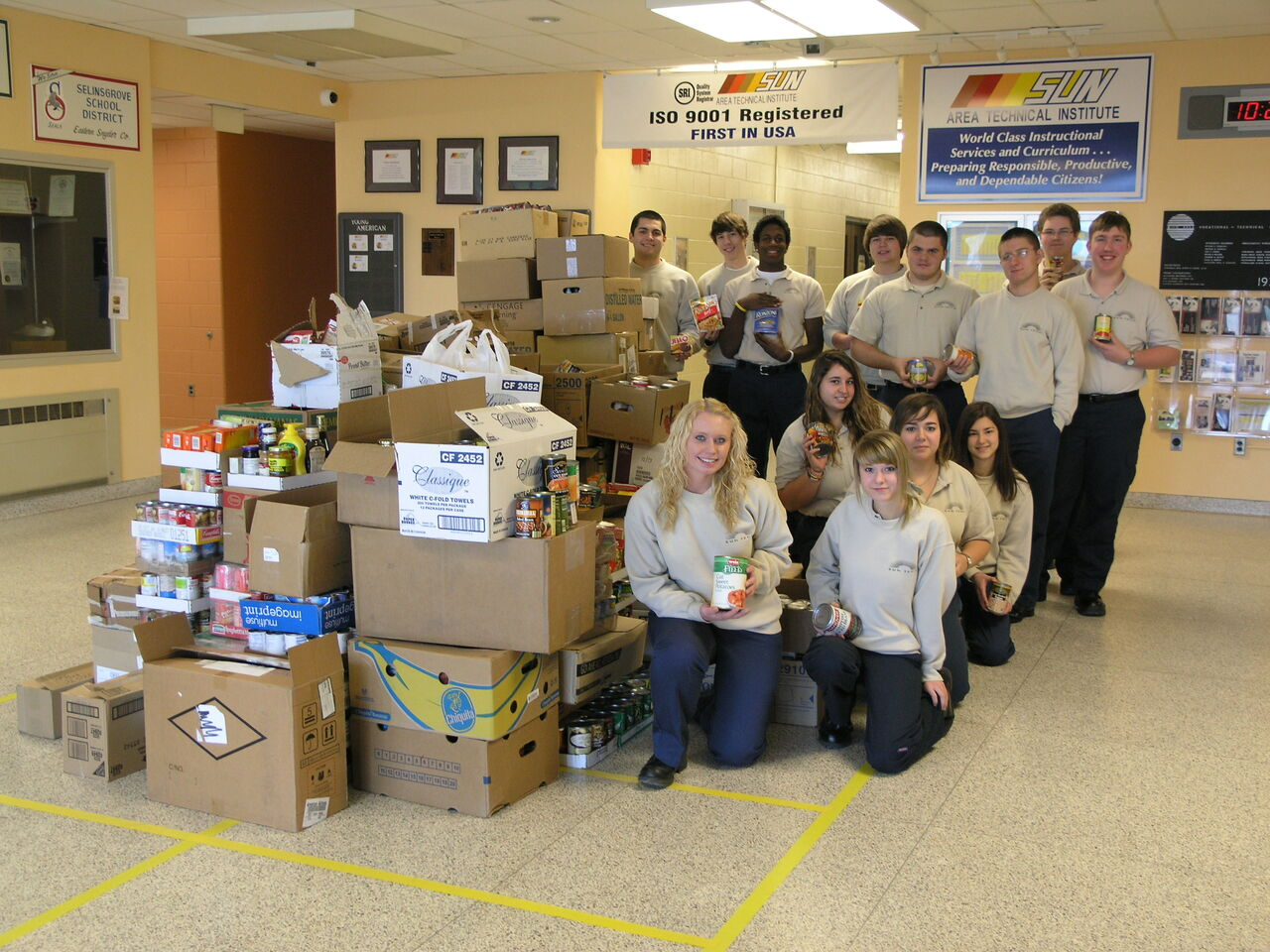 Criminal Justice poses with the mountain of food donated during the fall 2012 food drive.