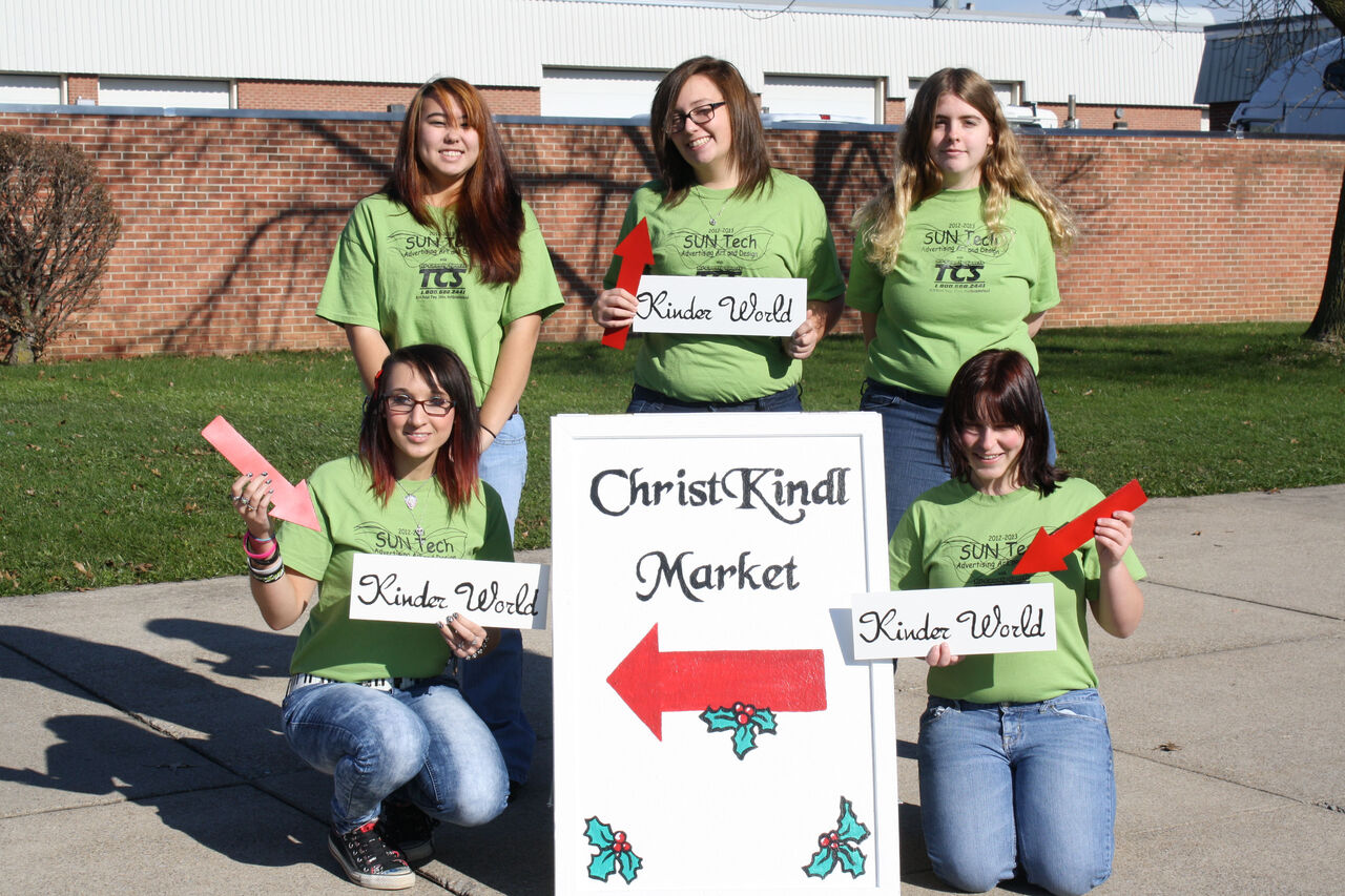 Ad Art Students and their Christkindle Signs
