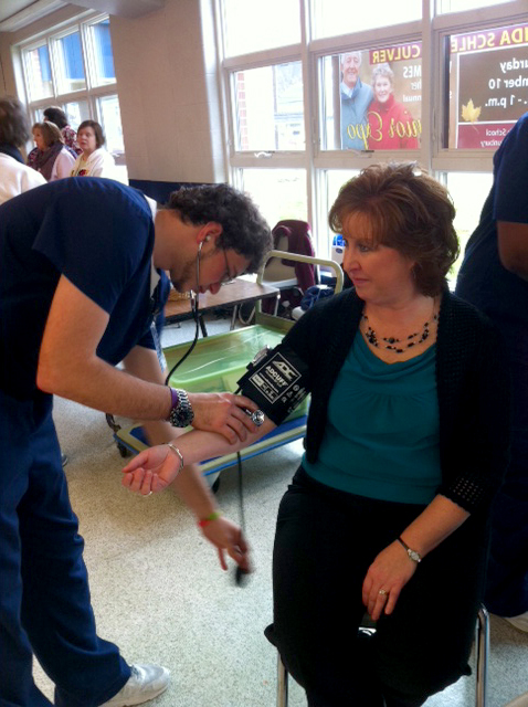 Representative Lynda Culver has her blood pressure taken at the 2012 Senior Expo