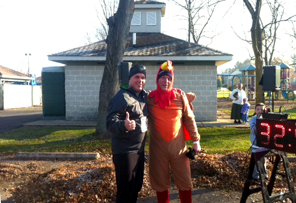 Co-Op Coordinator Joe Weisser poses with turkey trotter Drew Kelly of 94.1 WQKX