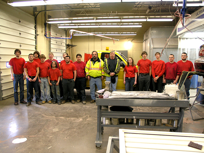 Collision Repair students pose with representatives of the City of Sunbury.