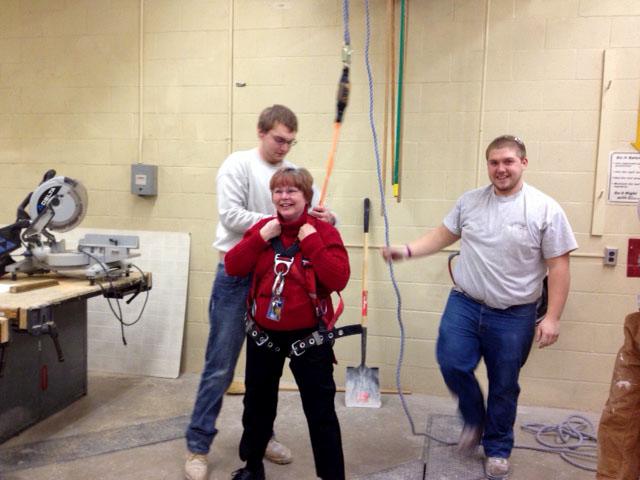 Mrs. Sharer Tries the Fall Arrest Harness