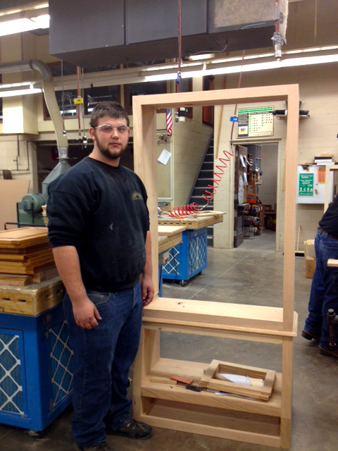 Steve France with his partially completed oak gun cabinet.