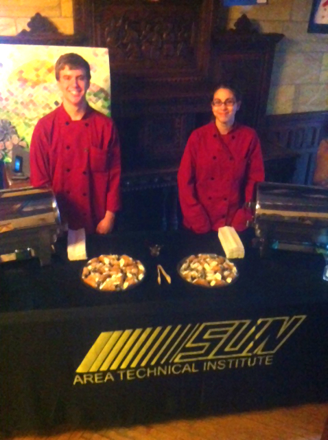 Cole and Amanda serve meatballs to attendees of the School Art Open House.