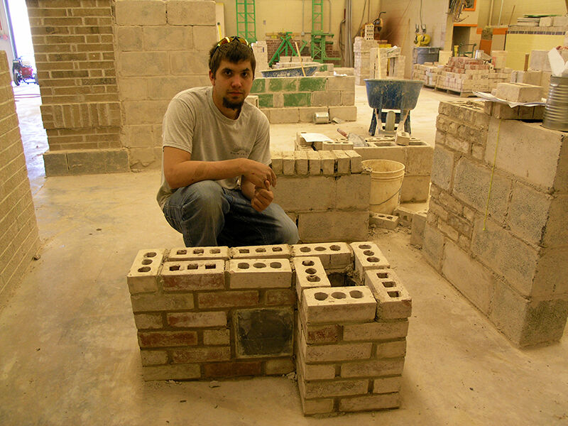 Wayne Dressler Poses with Masonry Project