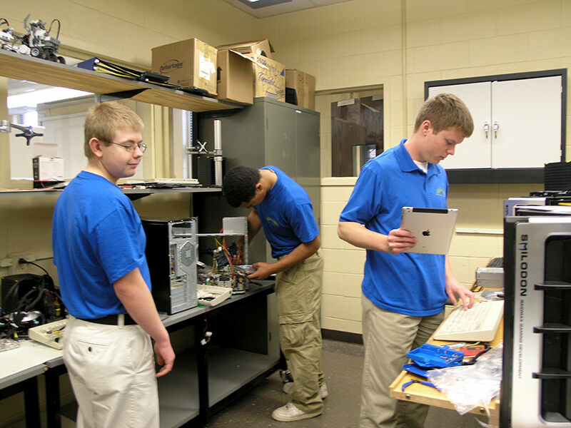 Electronics Technology Students Troubleshoot Desktop PC's