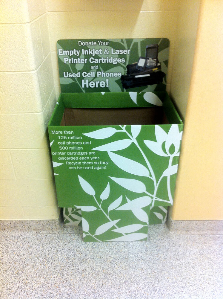 The bin is located at the back of the lobby as you enter the center hall.