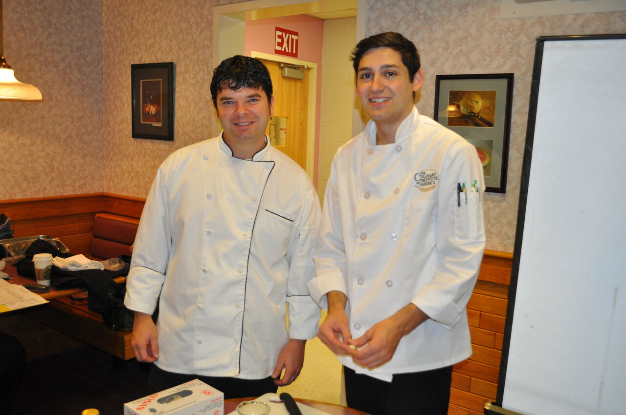 Food Service instructor Justin Wright (left) and Giovanni Ray (right) from the Culinary Institute of America