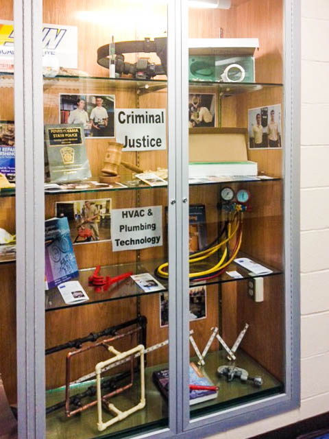 A display case at Mifflinburg features SUN Tech's Criminal Justice and HVAC programs.