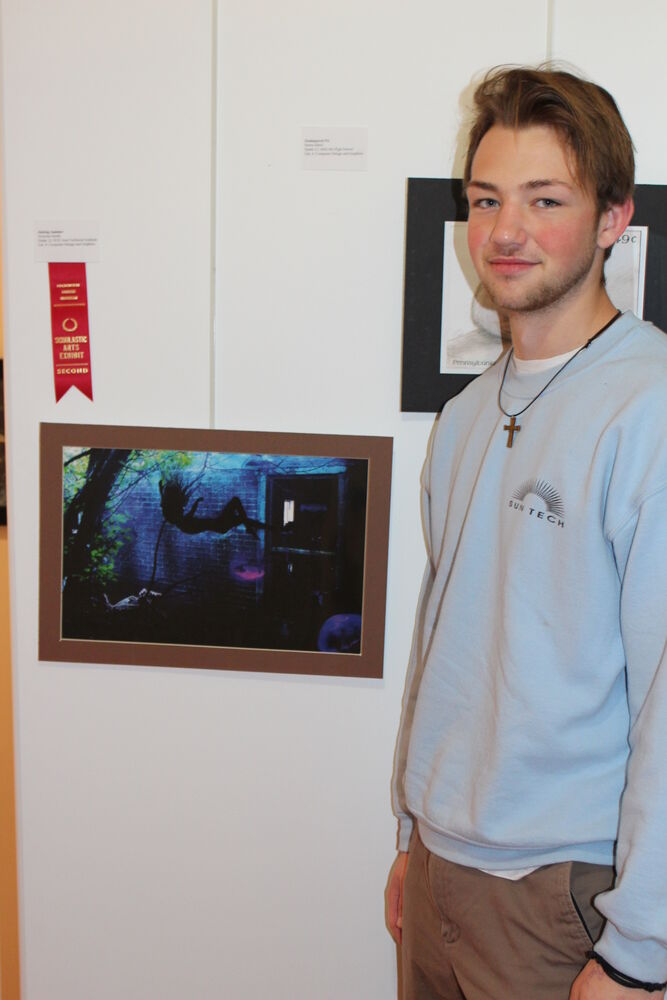 Nick Smith with his Scholastic Art 2nd place award winning computer design and graphics artwork at the Packwood House Museum.